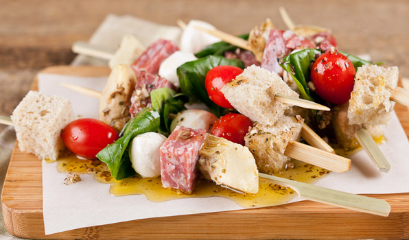 in the kitchen with stefano faita antipasto skewers served with dressing drizzled over them