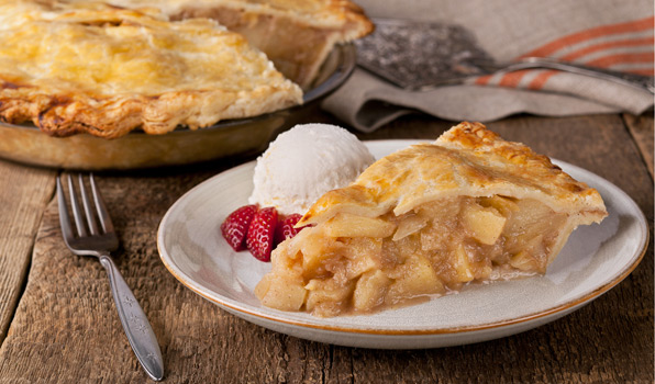 in the kitchen with stefano faita deep dish apple pie slice on a plate served with vanilla ice cream and strawberries