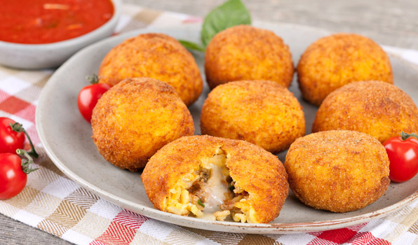 in the kitchen with stefano faita italian rice balls with tomato sauce served on a plate
