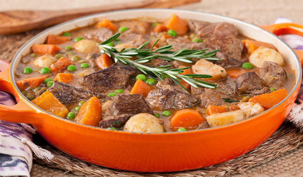 in the kitchen with stefano faita stefano's quick beef stew in a pot garnished with a sprig or rosemary