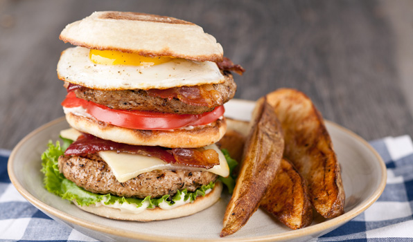 in the kitchen with stefano faita stefano's breakfast burger served on a plate with a side of baked fries