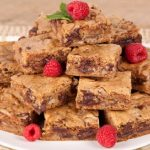 in the kitchen with stefano faita stefano's blondies served on a plate with raspberries