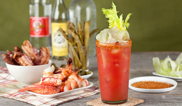 in the kitchen with stefano faita horseradish bloody mary garnished with shaved celery and served with shrimp, lobster, bacon and pickled green beans