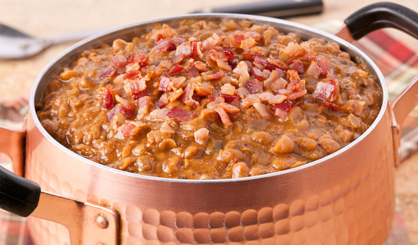 in the kitchen with stefano faita boston baked beans served in large pot with bacon bits on top
