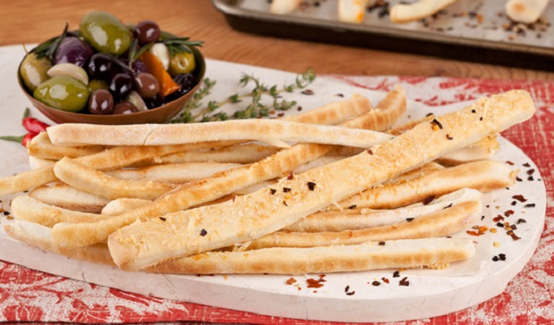 in the kitchen with stefano faita basic breadsticks served on a white plate with a side of assorted olives