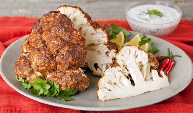 in the kitchen with stefano faita tandoori whole roasted cauliflower on a plate with tandoori paste on the side