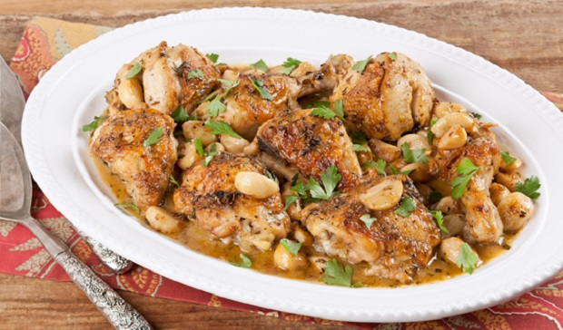 in the kitchen with stefano faita chicken with 40 cloves of garlic served on a white dish