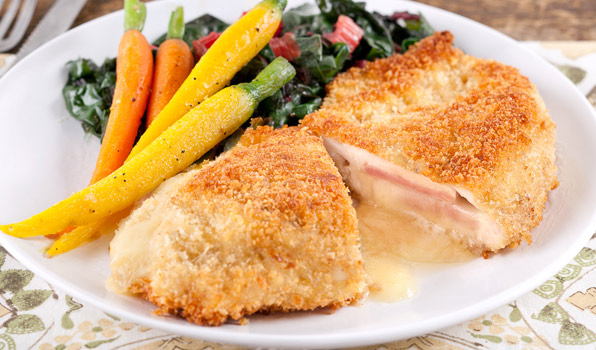 in the kitchen with stefano faita chicken cordon bleu served with vegetables on the side