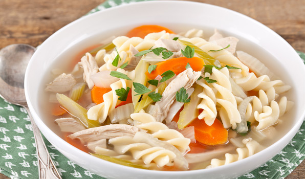 in the kitchen with stefano faita chicken noodle soup in a white bowl