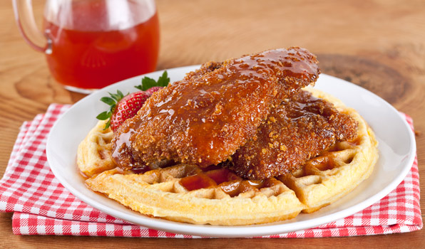 in the kitchen with stefano faita chicken and waffles with spicy maple syrup and strawberries as garnish