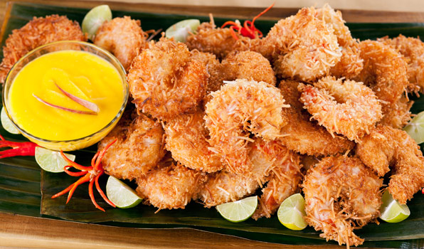 in the kitchen with stefano faita coconut shrimp with mango and ginger dipping sauce garnished with lime slices and chili peppers