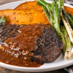 in the kitchen with stefano faita spicy rib eye steaks with maple coffee sauce served with baked sweet potatoes and grilled green onions