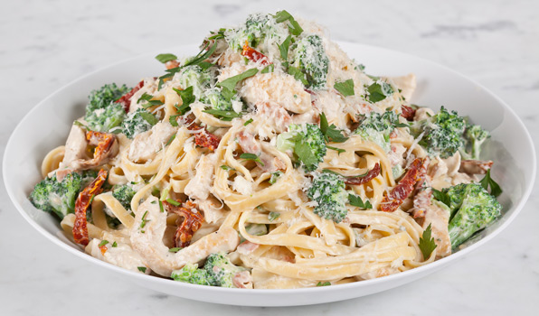 in the kitchen with stefano faita creamy chicken and broccoli pasta with grated parmesan cheese, parsley, thin slices of pancetta and chicken scallopine