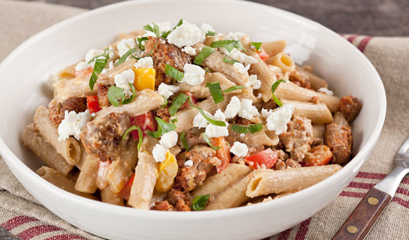 in the kitchen with stefano faita creamy sausage and pepper pasta served and garnished with some chopped parsley and a drizzle of olive oil