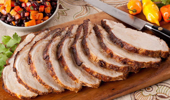 in the kitchen with stefano faita cuban style pork roast with papaya black bean salsa on a wood cutting board