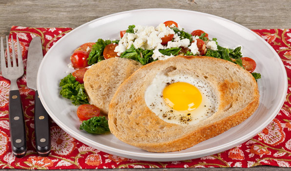 in the kitchen with stefano faita egg in the hole of bread slice served with a side of kale and cherry tomato sautée
