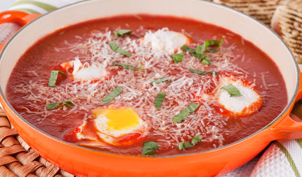 in the kitchen with stefano faita eggs in purgatory in an orange saucepan