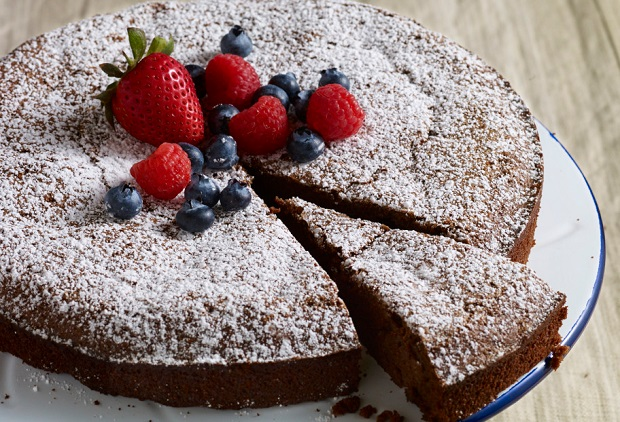 pati's mexican table nana jose's flourless chocolate pecan cake garnished with mixed berries and powdered sugar