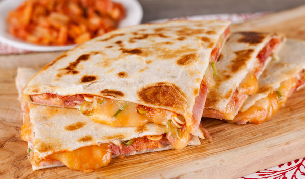 in the kitchen with stefano faita sweet and spicy ham quesadilla on a wooden board, served with kimchi on the side