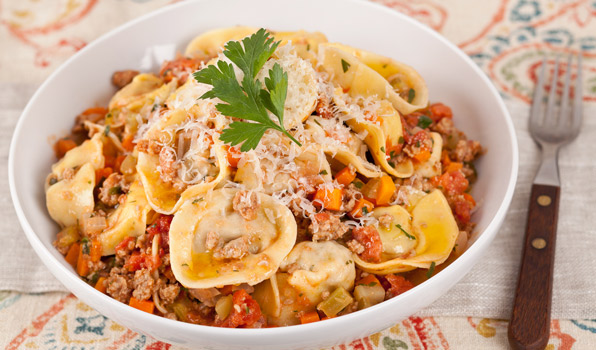 in the kitchen with stefano faita meat and cheese stuffed tortelloni in a white bowl with a fork