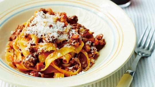 gino's italian escape gino's grandfather's tagliatelle alla bolognese served with parmesan shavings on top