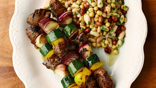 gino's italian escape marinated meat skewers with a three bean salad on the side
