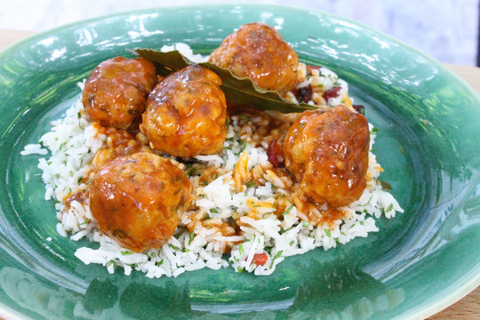 gino's italian escape herby veal meatballs with parmesan and pine nuts in tomato sauce served on top of a bed of rice
