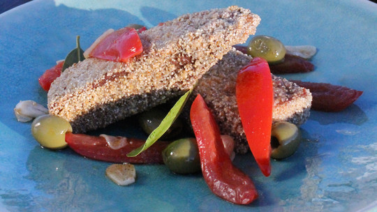 gino's italian escape semolina crusted fresh tuna served with sliced plum tomatoes and green olives