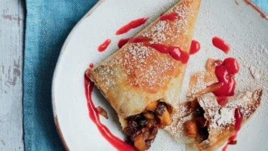 gino's italian escape no bake apple, raisin and amaretto strudel on plate with raspberry sauce drizzled over