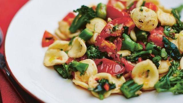 gino's italian escape orecchiette with broccoli and tomatoes served on plate