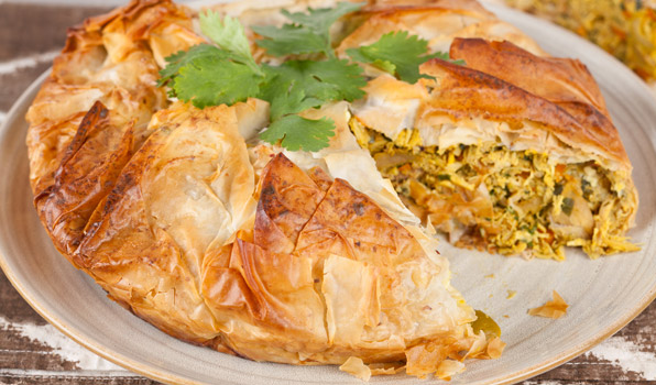 in the kitchen with stefano faita moroccan chicken pie on a dish garnished with parsley
