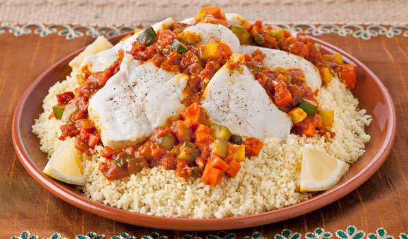 in the kitchen with stefano faita moroccan fish stew served on a bed of steamed couscous with lemon slices