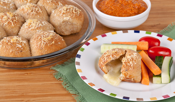 in the kitchen with stefano faita pizza bites with tomato dipping sauce served with carrot and cucumber sticks and cherry tomatoes