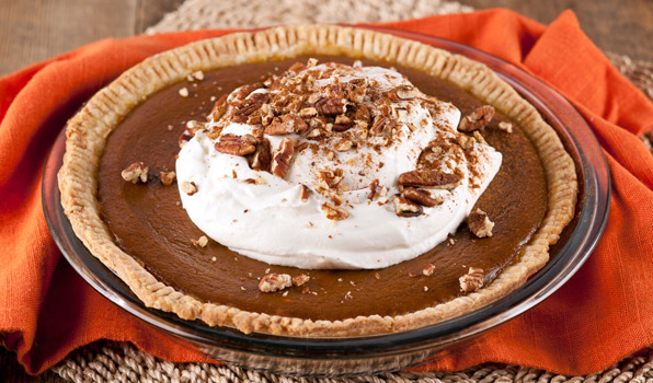 in the kitchen with stefano faita stefano's pumpkin pie garnished with whipped cream, chopped pecans and cinnamon