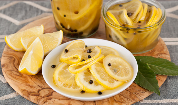 in the kitchen with stefano faita preserved lemons sliced thinly on a plate and jar and topped with peppercorns