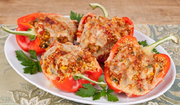 in the kitchen with stefano faita quinoa and sausage stuffed pepper served on a plate with parsley
