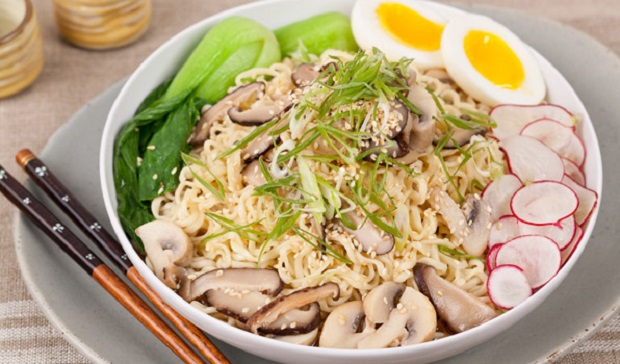 in the kitchen with stefano faita ramen noodle mushroom soup served in a white bowl on a plate with a pair of chopsticks