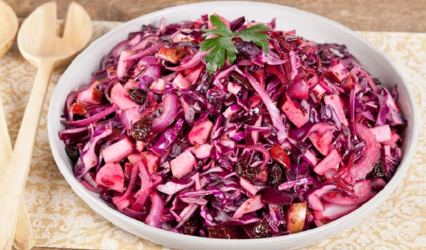 In the kitchen with Stefano Faita red cabbage and apple salad in a white bowl with wooden utensils