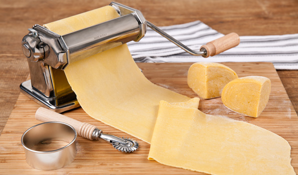 in the kitchen with stefano faita basic pasta dough in a pasta machine with parmesan on the side