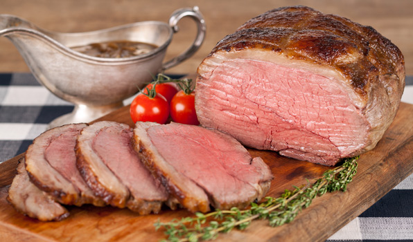 in the kitchen with stefano faita roast beef with caramelized onion gravy on a wooden cutting board
