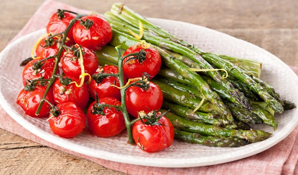 in the kitchen with stefano faita roasted cherry tomatoes and asparagus served on a dish