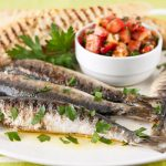in the kitchen with stefano faita grilled sardines with italian salsa on a plate garnished with parsley