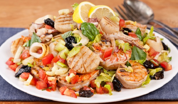 in the kitchen with stefano faita grilled seafood salad with lemon and utensils on the side