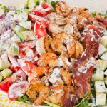 in the kitchen with stefano faita grilled shrimp and cobb salad on a plate