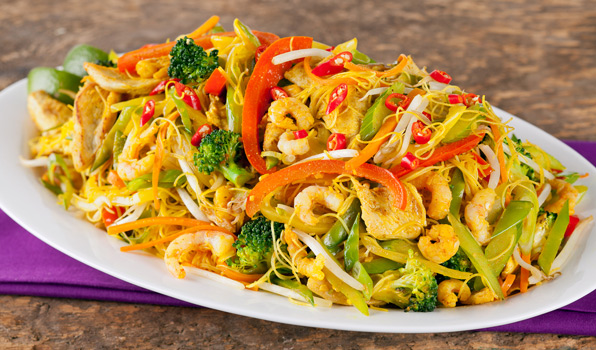 in the kitchen with stefano faita spicy singapore noodles on a white dish