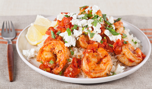 in the kitchen with stefano faita skillet shrimp with feta and tomato served over rice, drizzled with lemon juice and sprinkled with feta and mint
