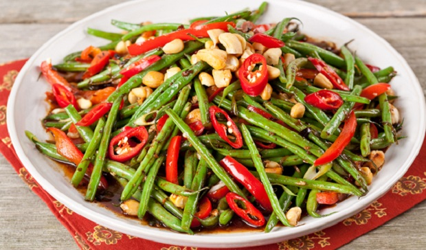 in the kitchen with stefano faita stir fried garlic green beans in a white dish