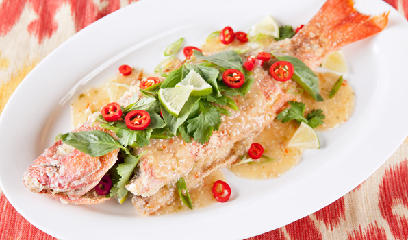in the kitchen with stefano faita crispy thai fried snapper on a plate garnished with lime slices,