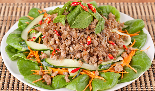 in the kitchen with stefano faita thai pork salad garnished with many mint leaves