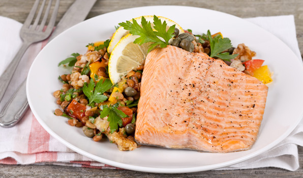 in the kitchen with stefano faita rainbow trout with lentil salad served on a plate